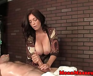 Mature masseuse ruins her clients orgasm