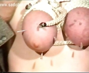 Hangin slave got hit on her tits and in her face also her boobs got tied with a rope